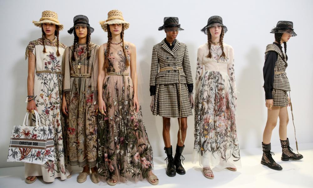 Models wearing long floral skirts.