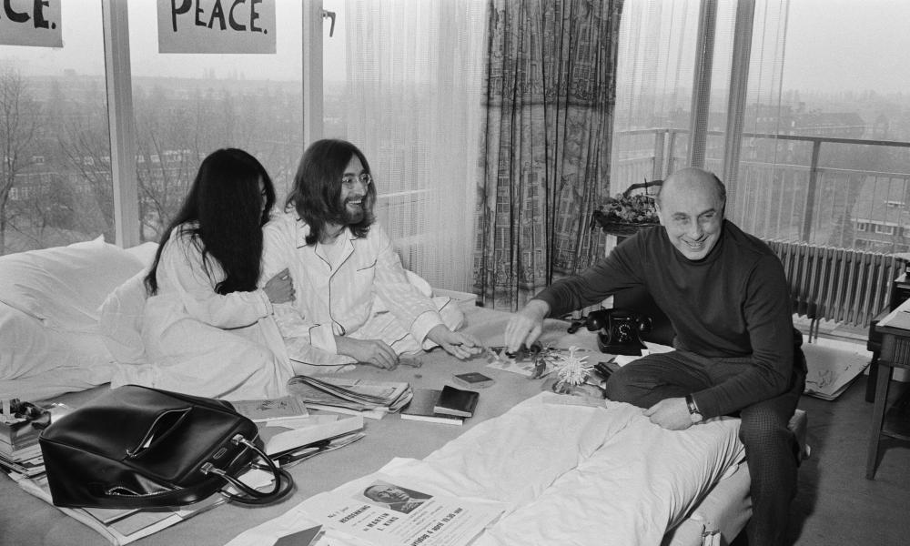 Donald Zec, right, interviewing John Lennon and Yoko Ono during their 'bed in' for peace at the Hilton hotel in Amsterdam, 1969.