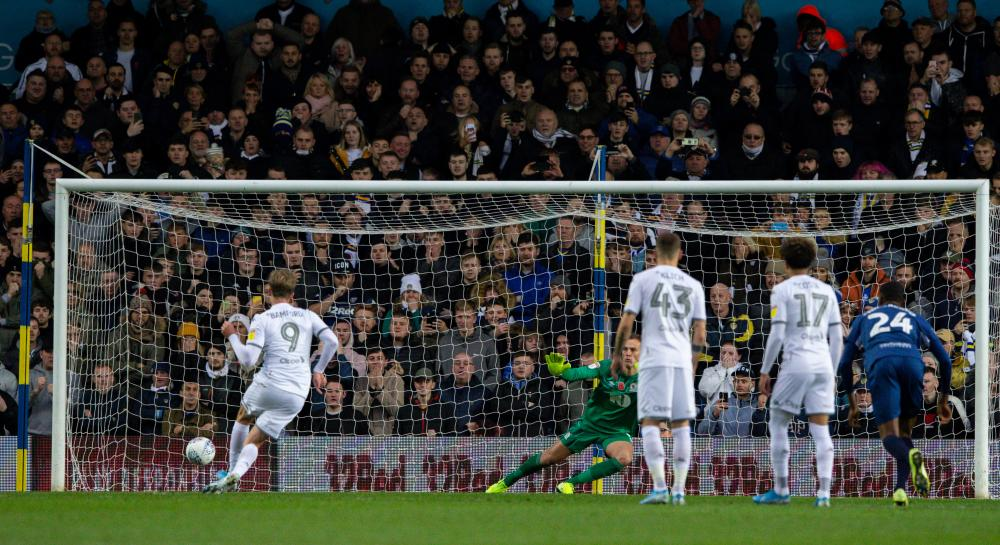 Leeds United's Patrick Bamford sends the keeper the wrong way to open the scoring.