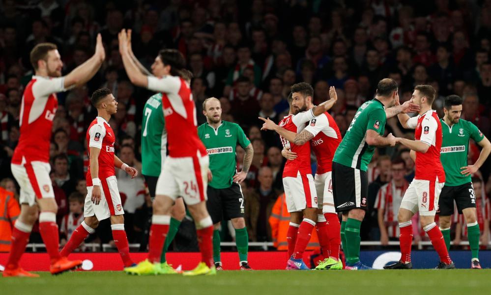 Arsenal's Theo Walcott celebrates scoring their first goal with team mates.
