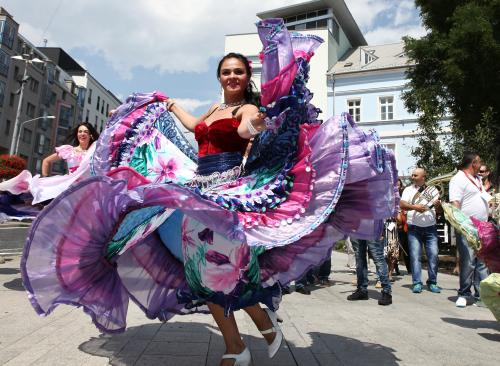 Performers in traditional costume dance during Gypsy Fest - World Roma festival in Bratislava, Slovakia