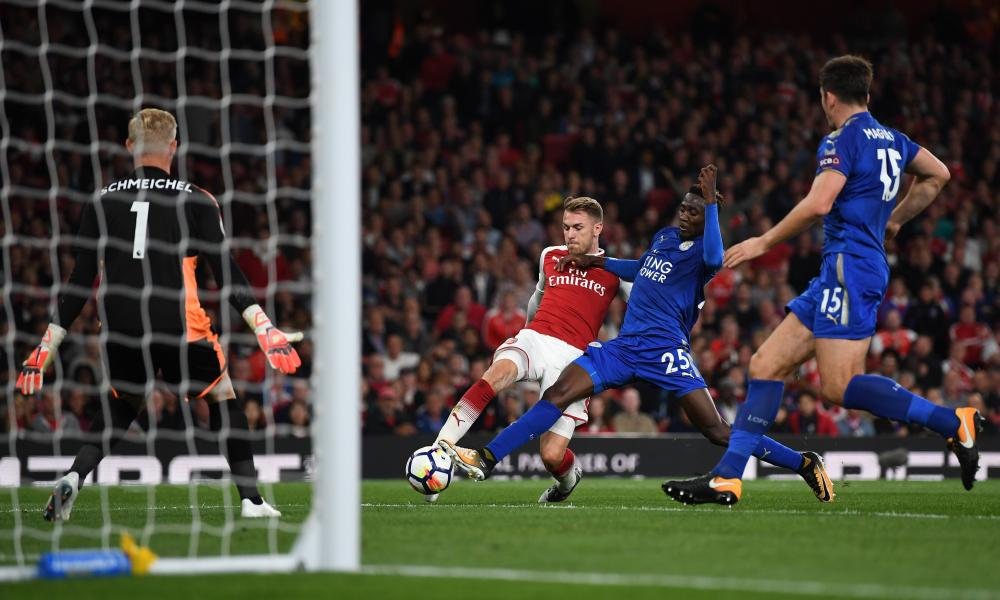 Aaron Ramsey shoots past Wilfred Ndidi to score his team's third.