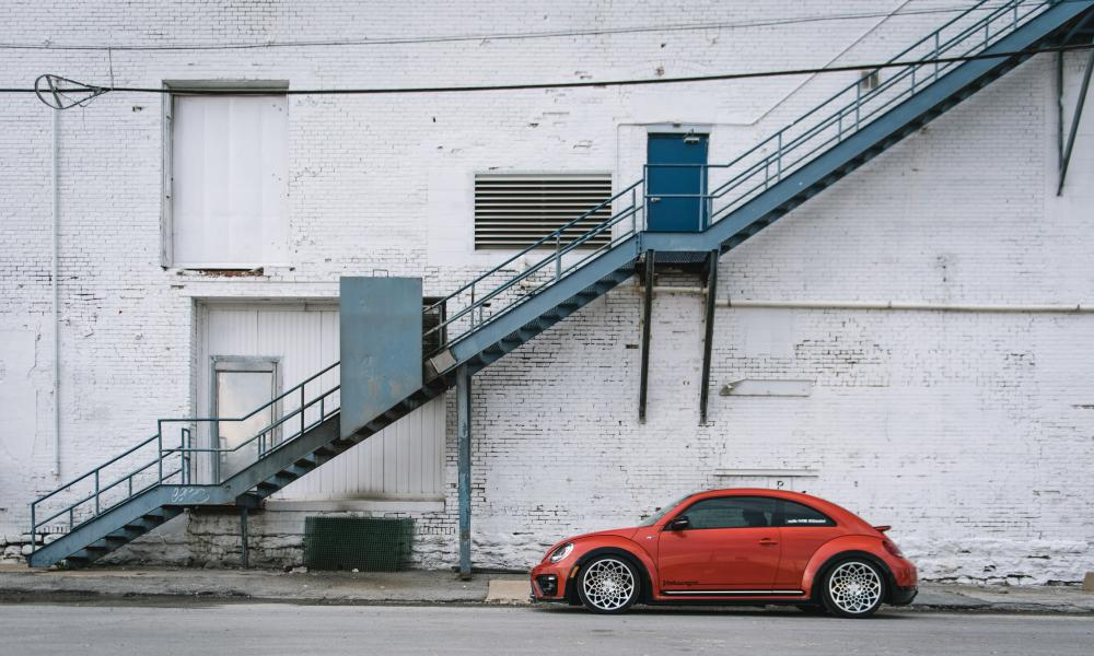 A modified version of the new Beetle parked under a staircase