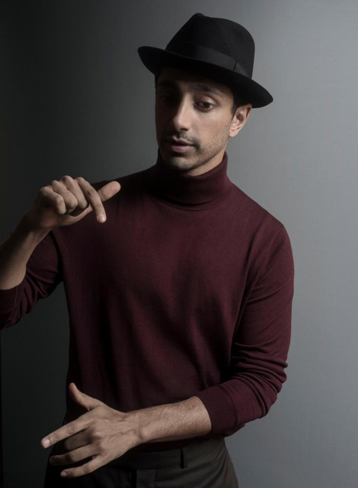 Rocket man: Riz Ahmed wears roll neck by Pringle of Scotland; trousers by Dior Homme; and fedora by Lock & Co Hatters (Mr Porter).