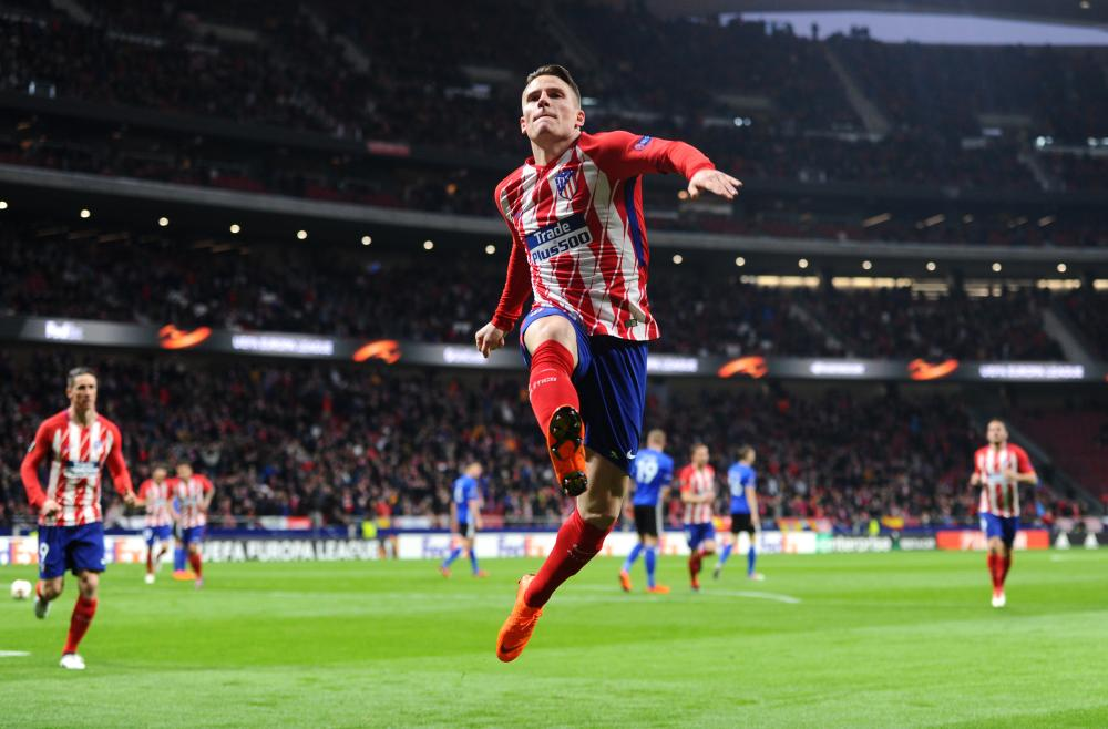 Atletico's Kevin Gameiro celebrates after scoring the only goal during the first half in Madrid.