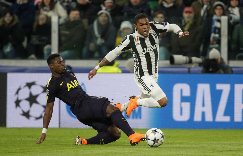 Reckless from Serge Aurier as he brings down Douglas Costa.