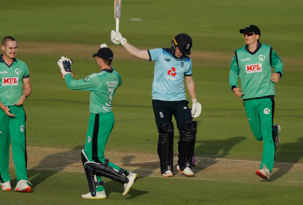 Despair for Eoin Morgan as he is dismissed by Josh Little (far left) for a duck.