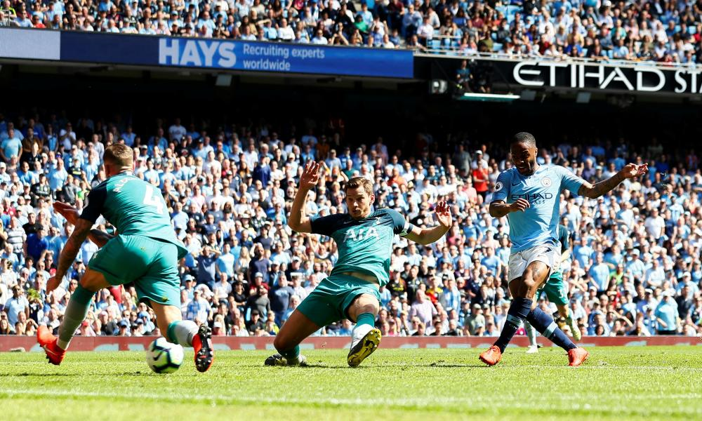 Manchester City's Raheem Sterling shoots.
