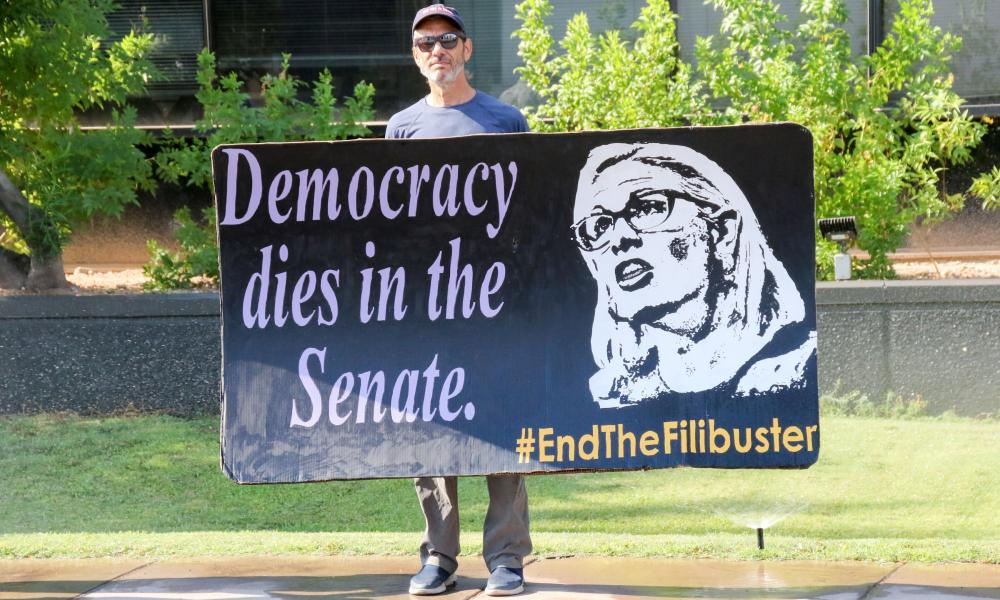 A protester outside Sinema's office in Phoenix.