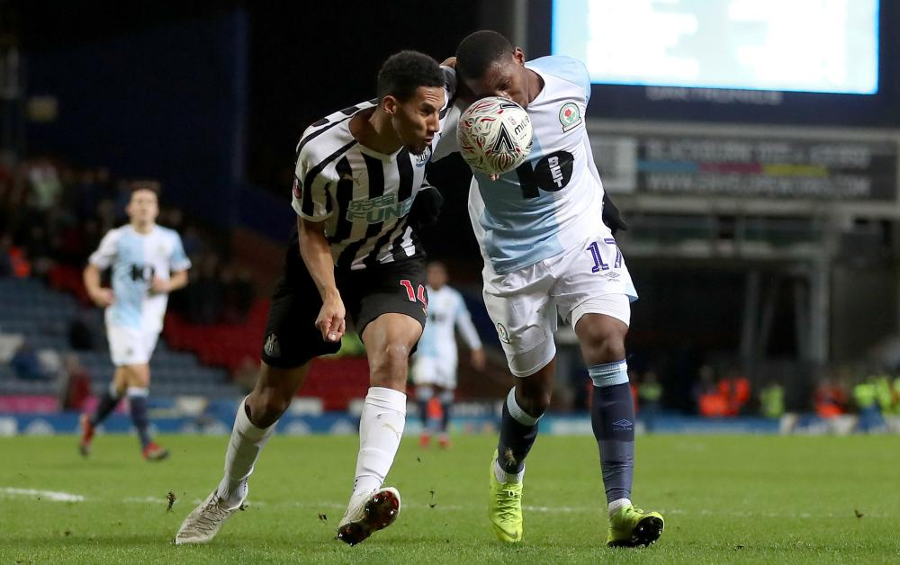 Newcastle United's Isaac Hayden and Blackburn Rovers' Amari'i Bell battle for the ball.