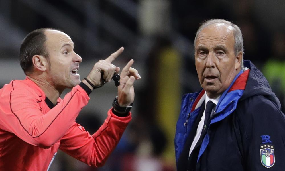 Referee Antonio Mateu Lahoz of Spain gestures when talking to Italy coach Gian Piero Ventura.
