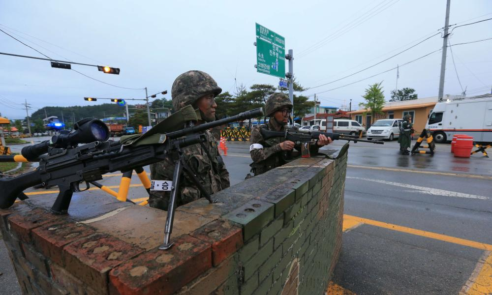 South Korean soldiers man a checkpoint near the demilitarised zone (DMZ) at Goseong.