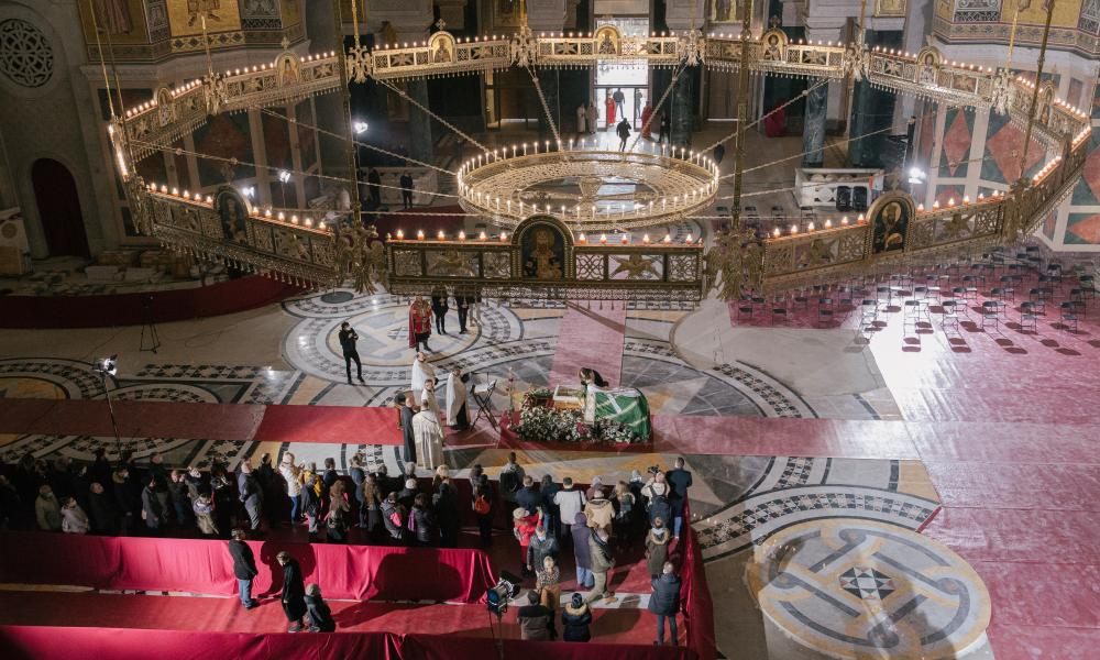 Mourners pay their respect over the casket of Serbia's late Patriarch Irinej during his funeral service on Saturday.