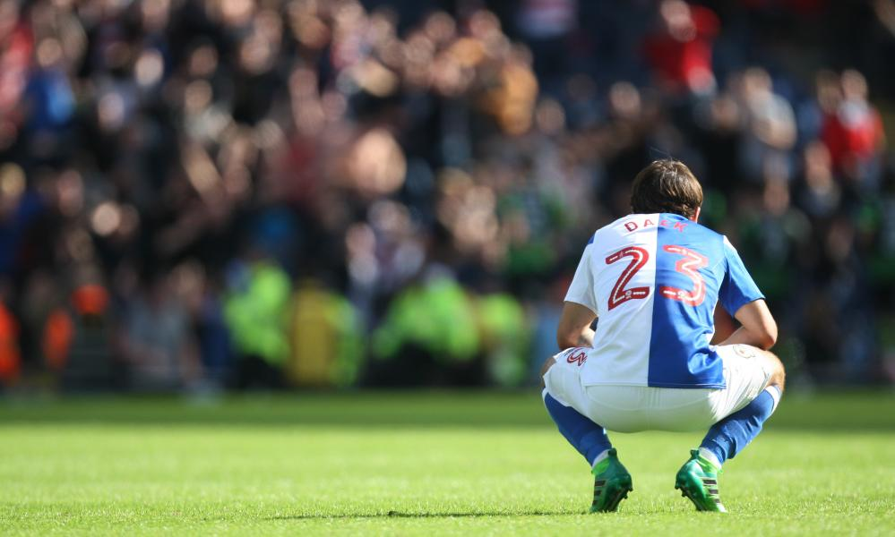 New Blackburn signing Bradley Dack reacts to Doncaster's third goal.