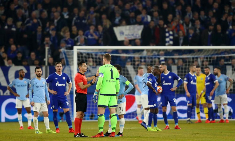 Referee Carlos Del Cerro Grande talks to Schalke's Ralf Fahrmann and Manchester City's David Silva.