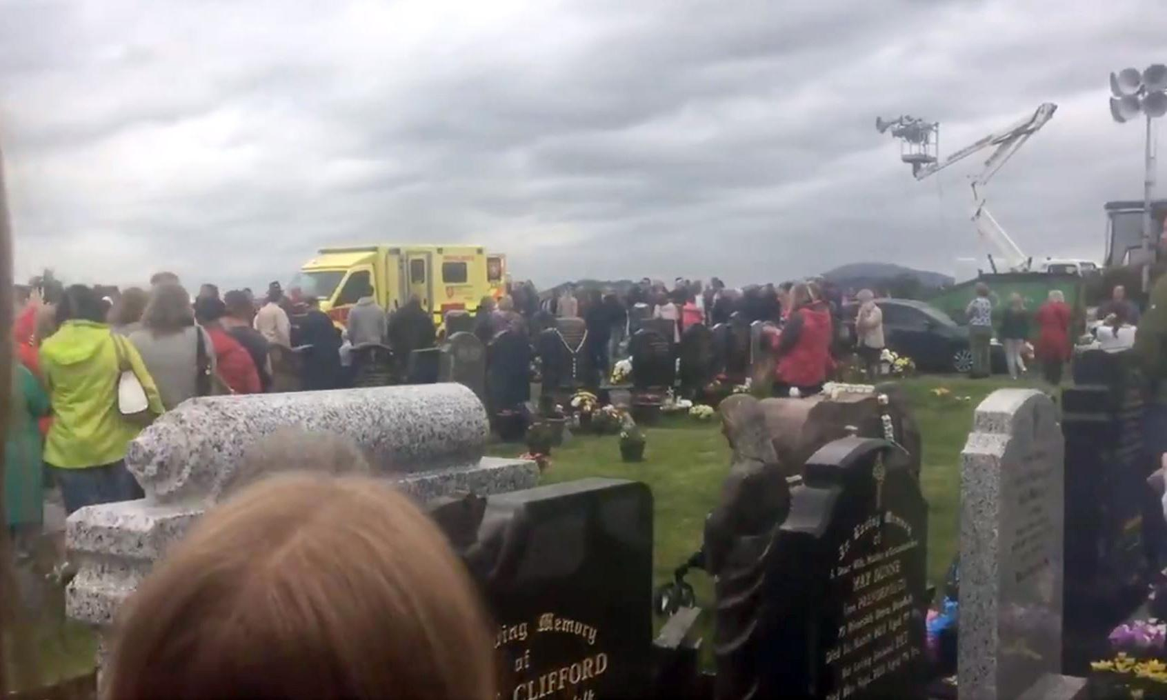 Man injured after driver ploughs through crowd at Irish cemetery