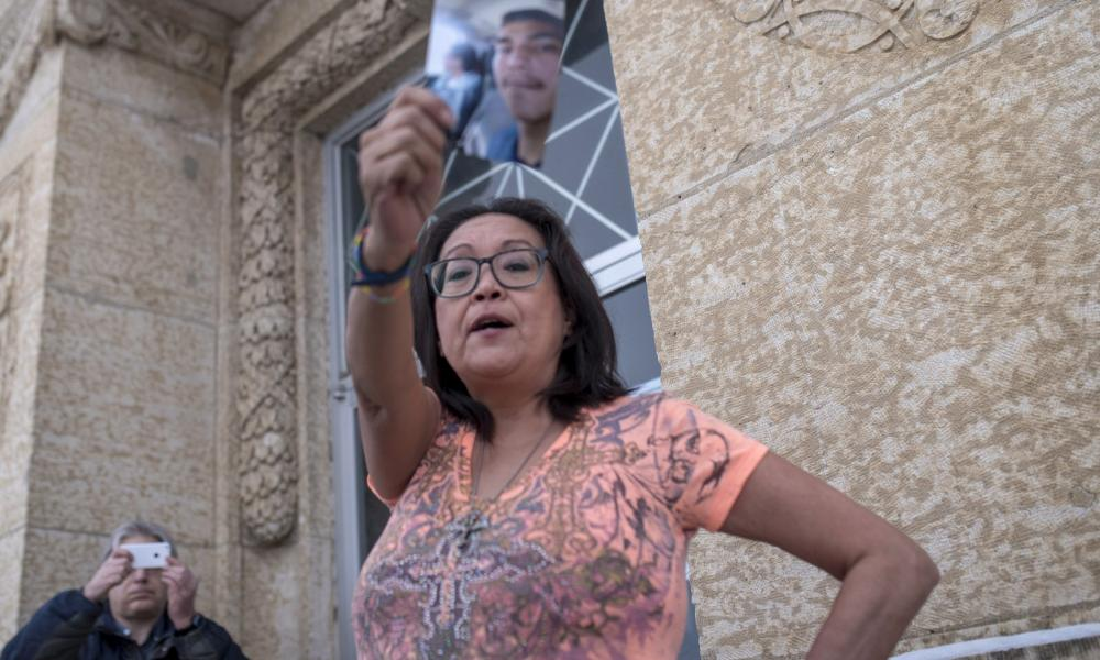 Debbie Baptiste holding a picture of her son, Colten Boushie, at the trial of Gerald Stanley, the white farmer accused of killing Boushie, from Saskatchewan's Red Pheasant First Nation.
