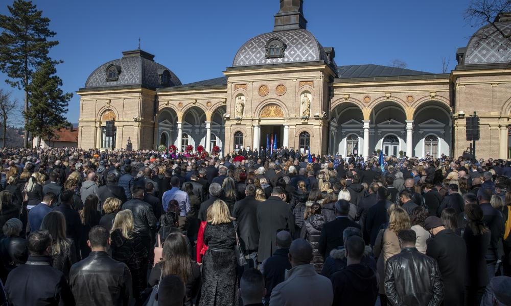 Mourners gather for the the funeral ceremony of Zagreb mayor Milan Bandic in Zagreb, Croatia, Wednesday, March 3, 2021.