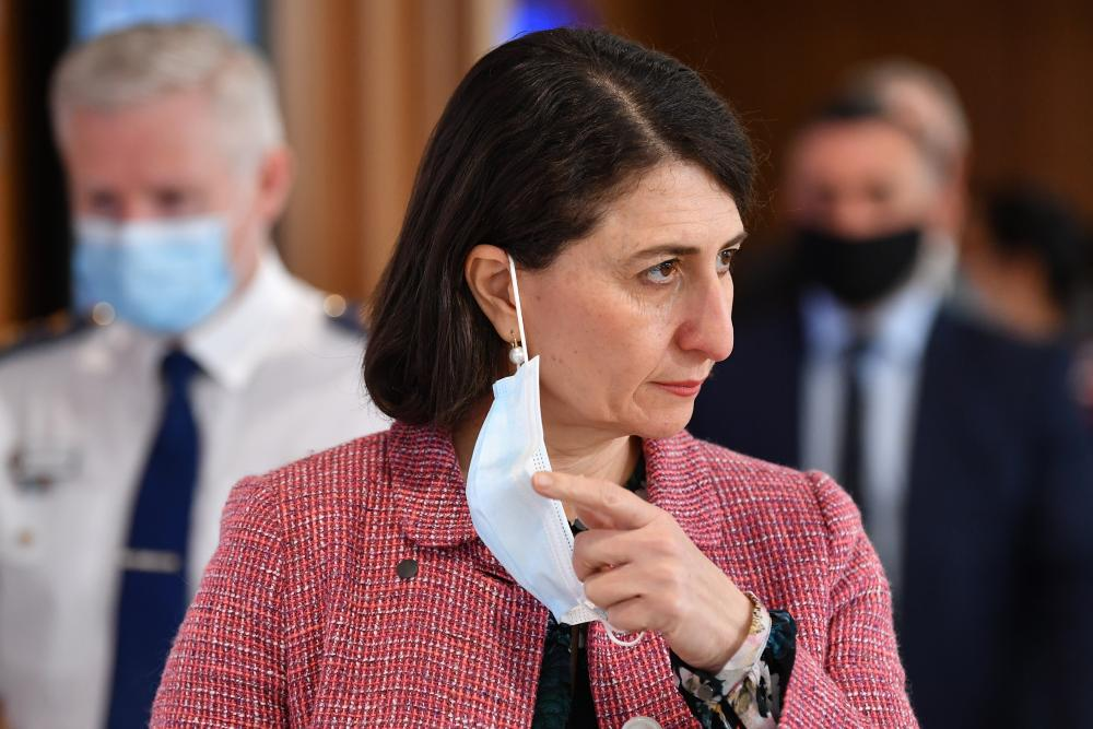 NSW premier Gladys Berejiklian arrives to speak to the media during a press conference in Sydney