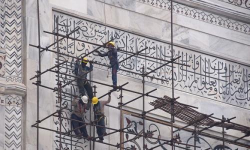 Labourers work on the Taj Mahal.