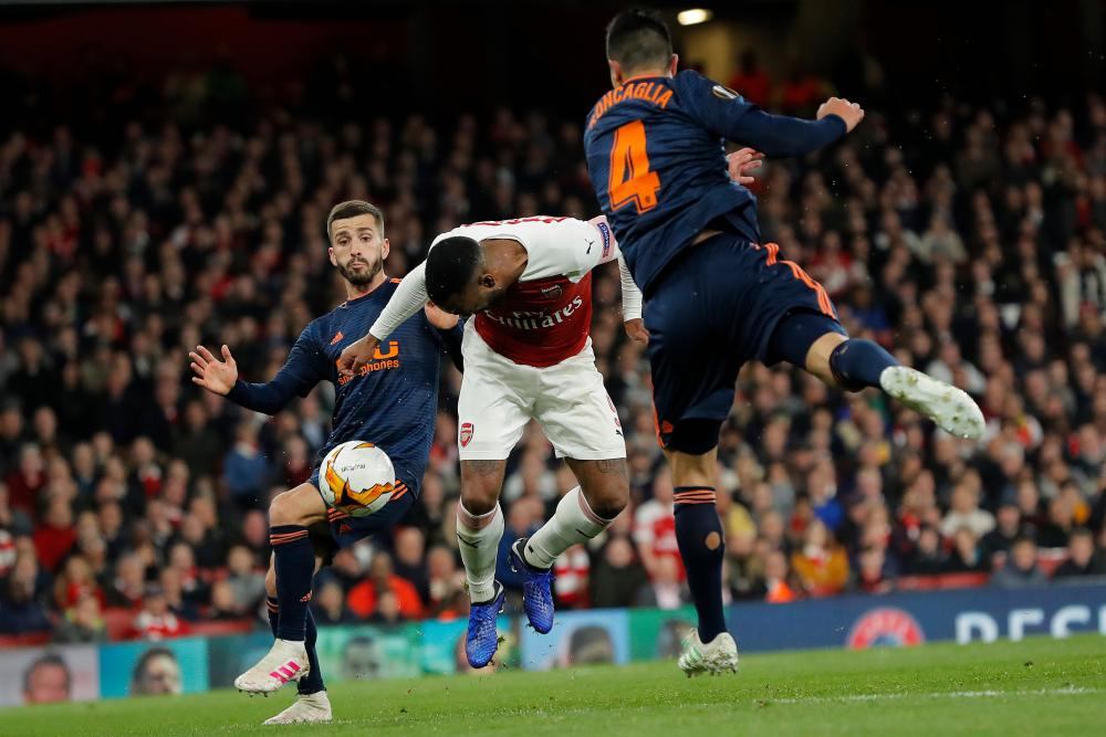 Alexandre Lacazette missed the ball as he goes for a header.