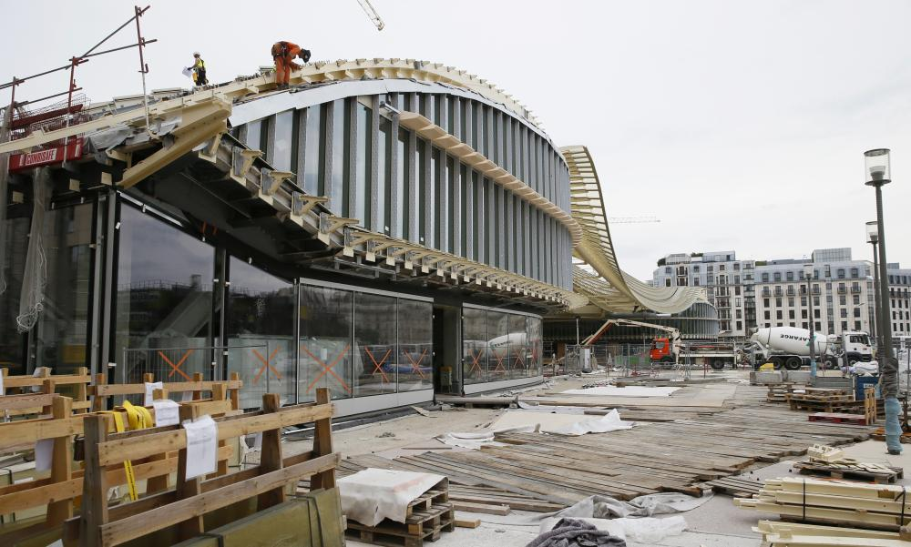 Workers work on the building site of Les Halles.