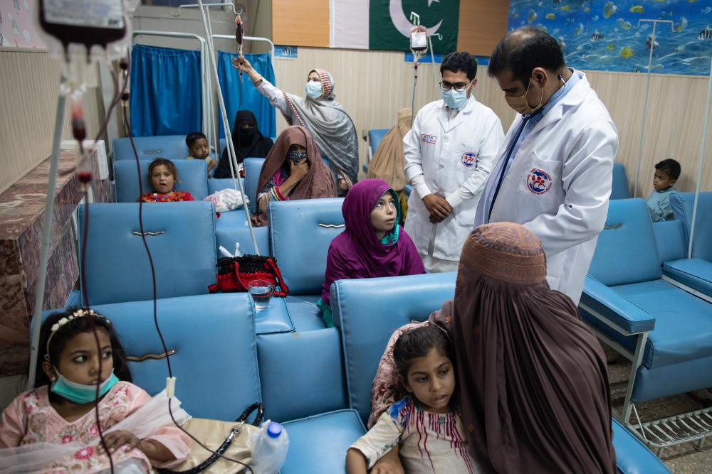 Doctors attend to patients at Hamza Foundation on 29 September in Peshawar, Pakistan.