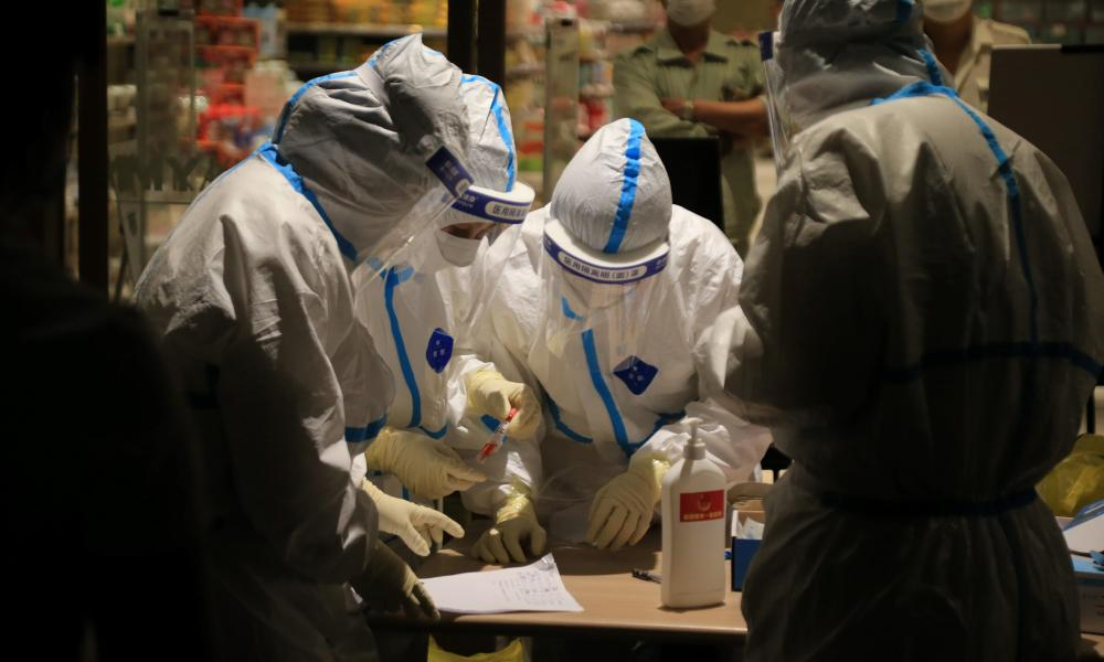 Health workers carry out Covid-19 coronavirus tests in a shopping mall in Dalian, in China's northeast Liaoning province.