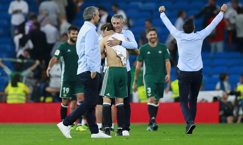 Quique Setién and his Betis staff celebrate at full-time.