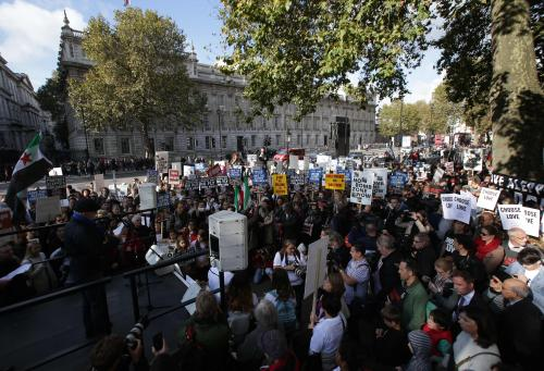 Hundreds of demonstrators listen to speeches outside Downing Street. Several campaign groups and charities including Avaaz and Amnesty International organised a rally in London to call on the British government to set out a plan to protect Syrian children in the embattled Syrian city of Aleppo