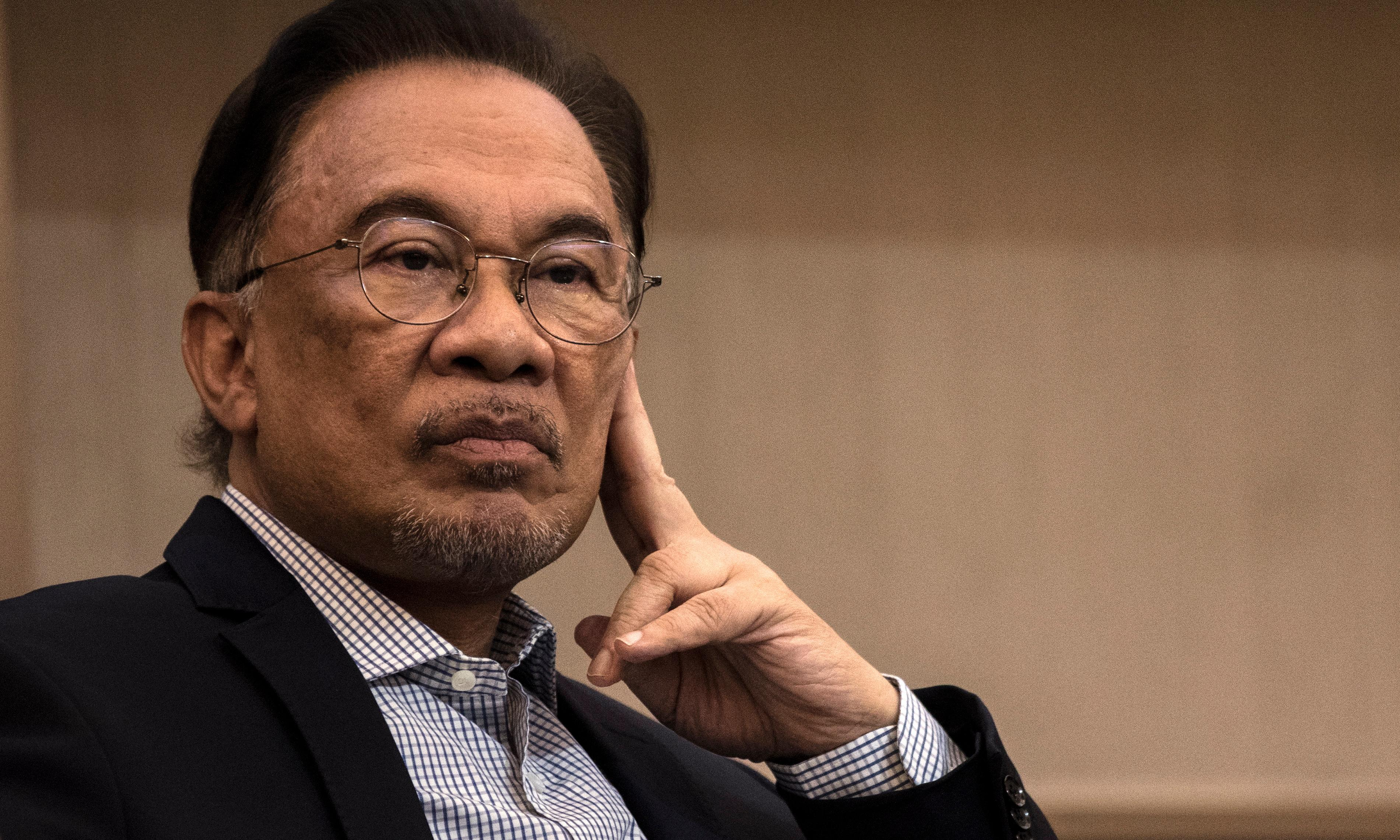 Anwar Ibrahim decries 'traitors' amid cracks in deal to make him Malaysia's next PM