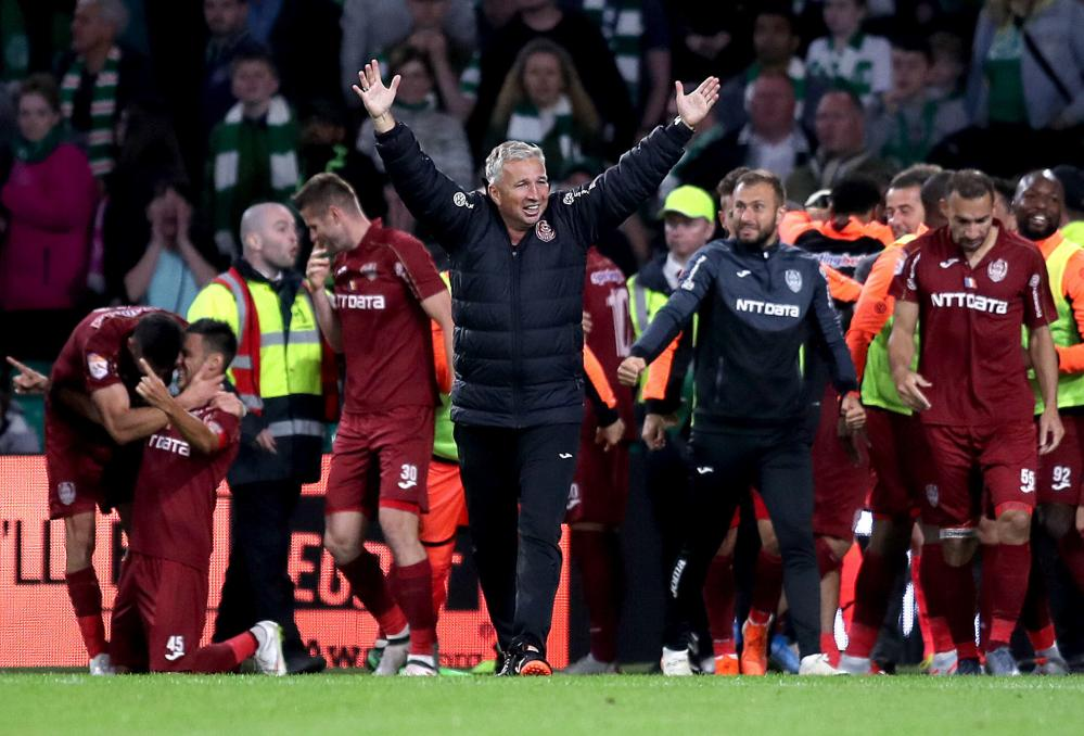 Cluj's manager Dan Petrescu celebrates victory after the final whistle.