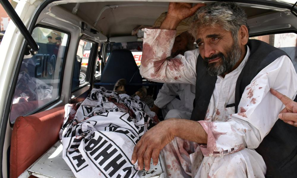 A man mourns the death of a relative, who was killed in a suicide blast in Quetta