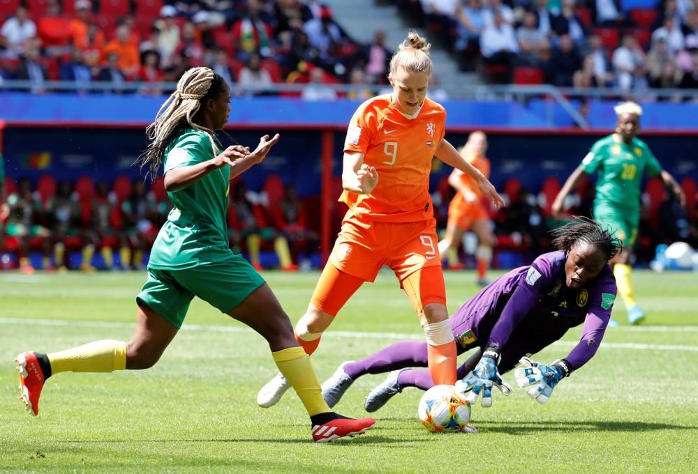 Netherlands' Vivianne Miedema is denied by Cameroon's Annette Ngo Ndom.