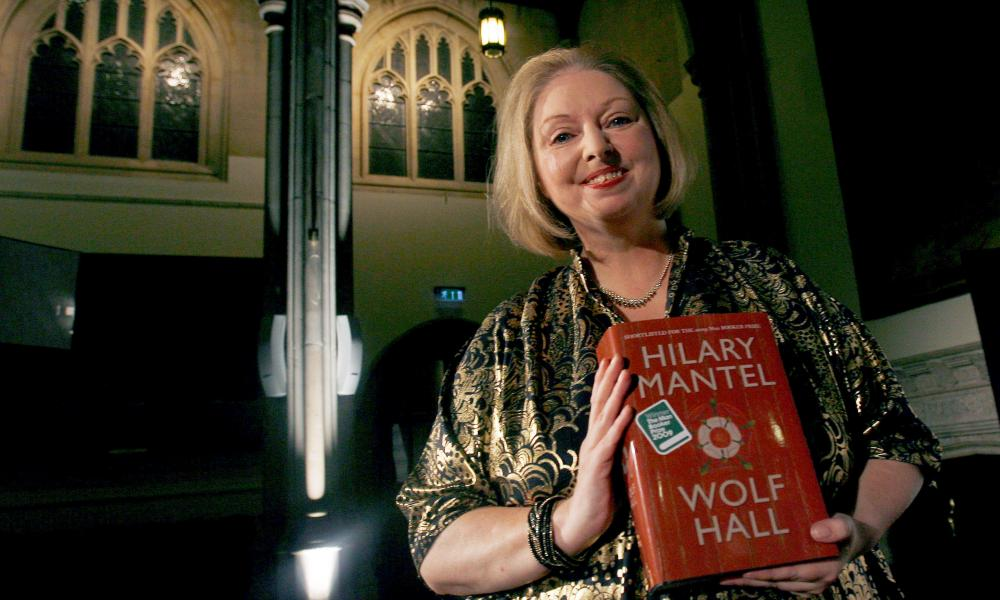 Hilary Mantel with a copy of her 2009 Booker-winning novel Wolf Hall.