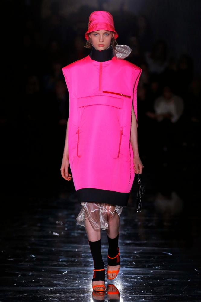 A matching neon tunic dress and bucket hat on the Prada catwalk.