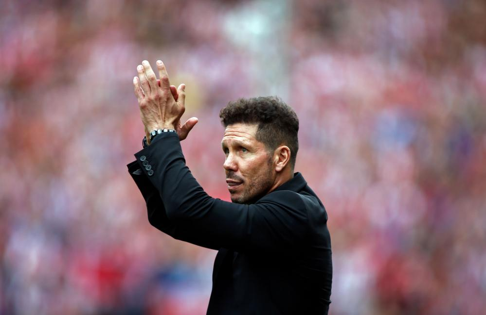 Diego Simeone greets the fans at the Vicente Calderón stadium.