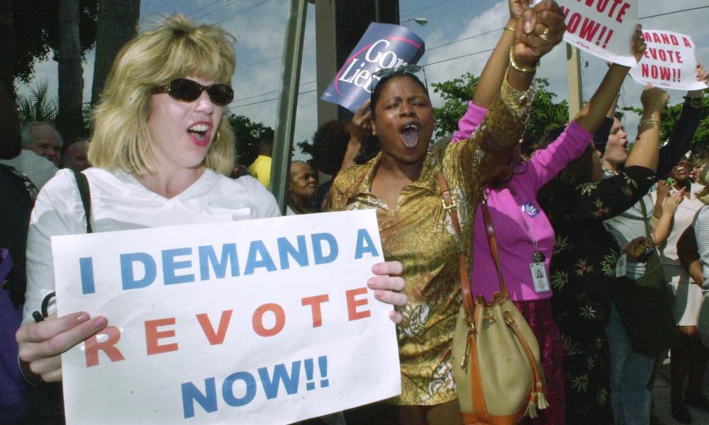 Demonstrators in Palm Beach County, Florida, demand a revote of the 2000 presidential election.