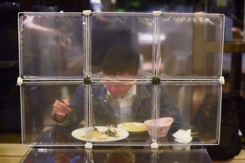 A restaurant separating diners with table partitions as a preventive measure against the Covid-19 coronavirus in Ningbo, in eastern China's Zhejiang province.