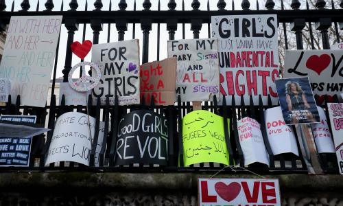 Protest banners are left in Duncannon Street, London, following a march to promote women's rights in the wake of the US election result.