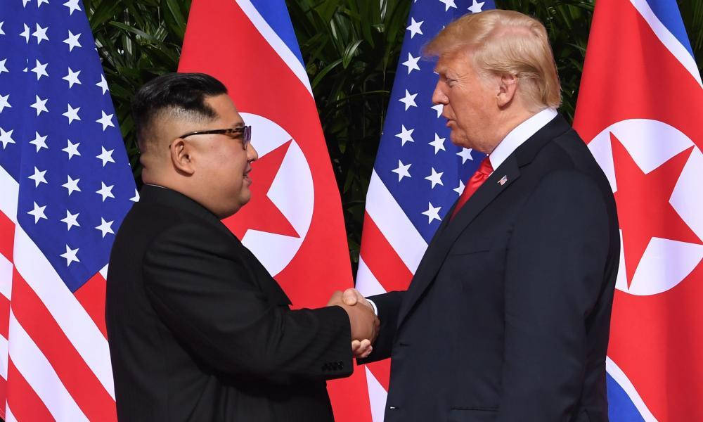 Trump and Kim shake hands at the start of their historic US-North Korea summit at the Capella hotel on Sentosa island.