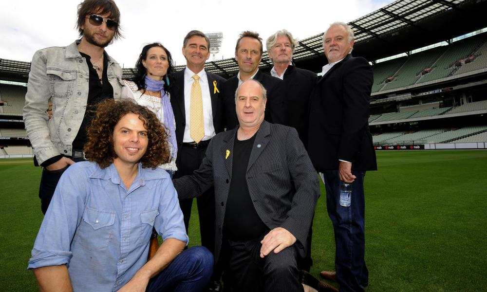 Michael Gudinski (bottom right) with (L-R) Nic Cester (Jet), Andrew Stockdale (Wolfmother), Kasey Chambers, Victorian premier John Brumby, Mark Seymour (Hunters & Collectors), Tim Finn and Mark Pope at the MCG in Melbourne in February 2009.