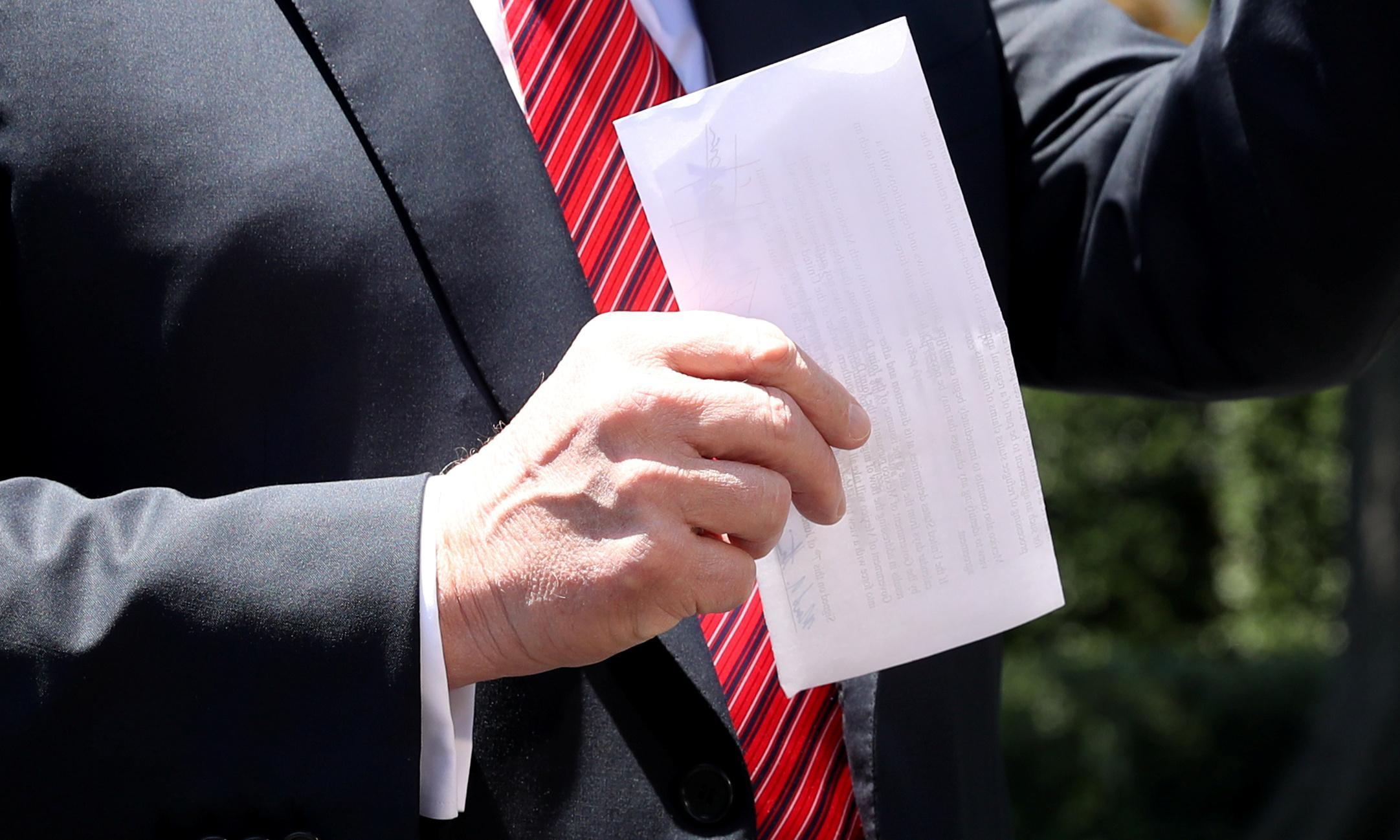 Donald Trump shows off 'secret' Mexico document but photos reveal contents