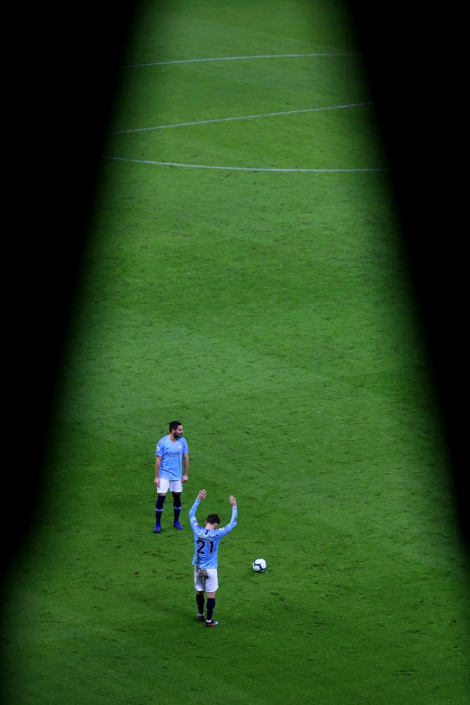 March 9: David Silva of Manchester City prepares to take a free kick against Watford at Etihad Stadium.