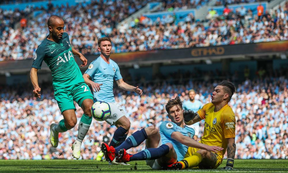 Lucas Moura of Tottenham Hotspur has his shot blocked and saved by John Stones of Manchester City and Goalkeeper Ederson.