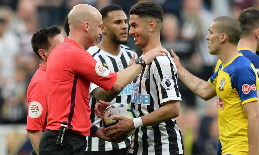 Ayoze Perez of Newcastle United gets the match ball from referee Anthony Taylor after his hat-trick.