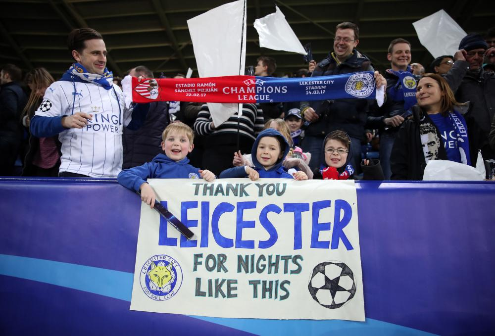 Leicester fans celebrate after an amazing night at the King Power Stadium.