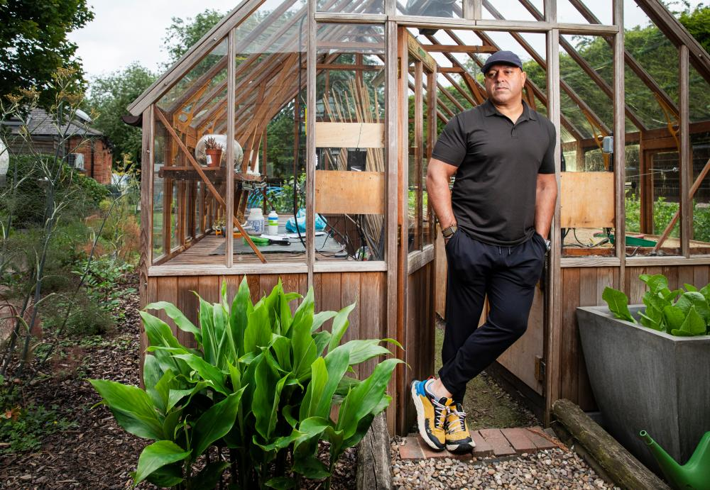 Chef Sat Bains in his restaurant's kitchen garden