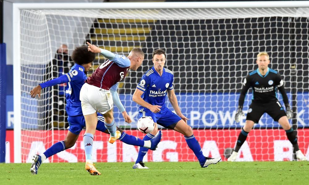 Ross Barkley shoots to score the winner for Aston Villa, past Kasper Schmeichel in the Leicester goal