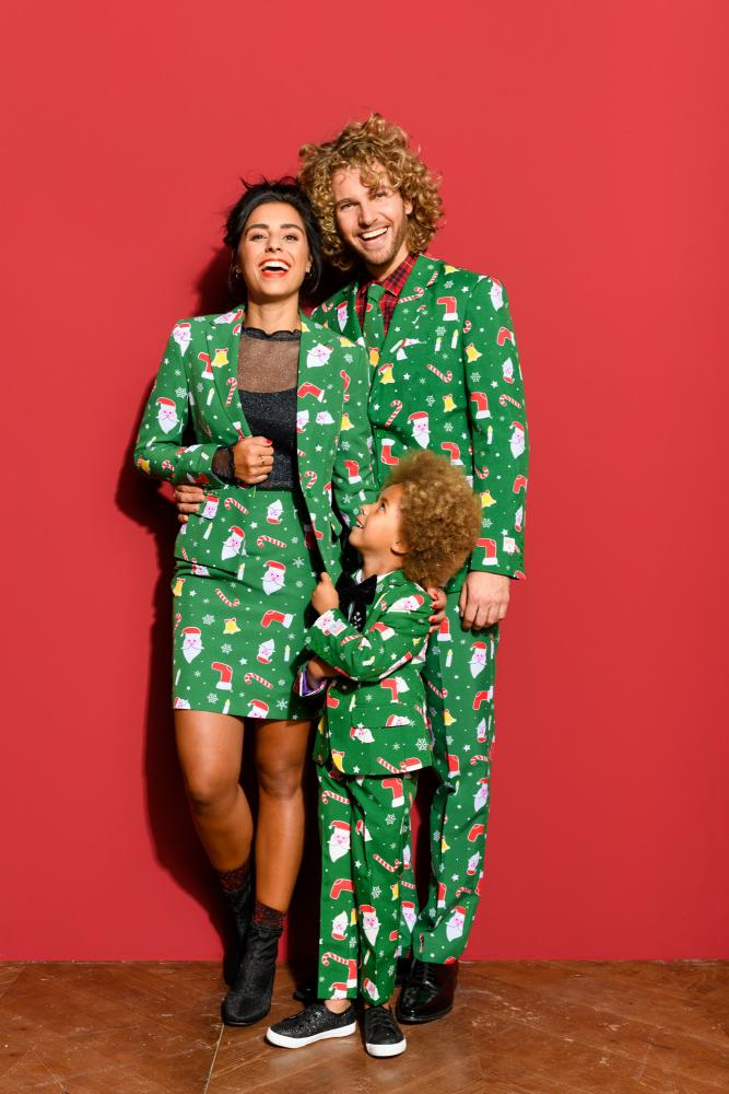 a family wearing garish green Christmas suits